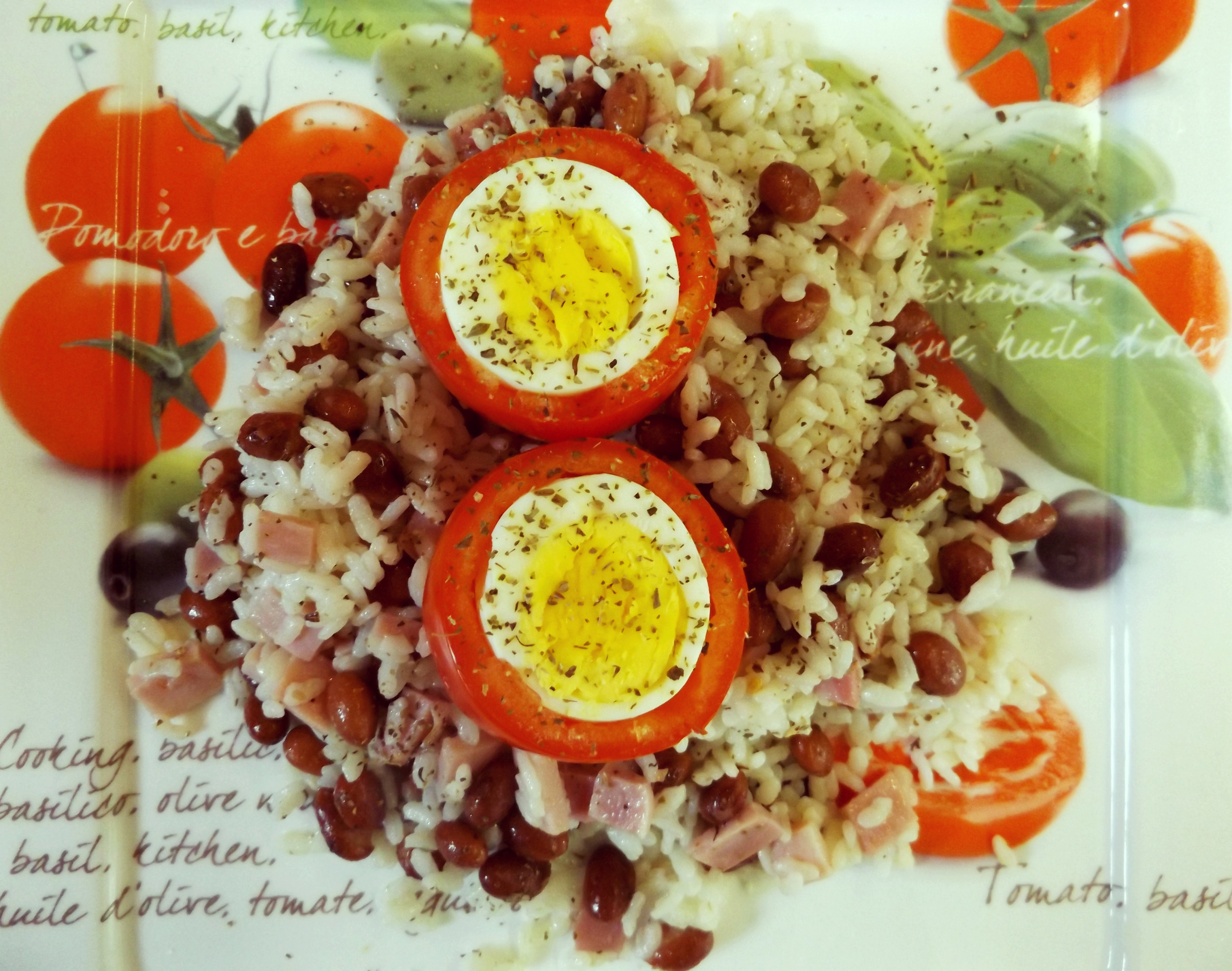 Rice, beans and ham salad with tomatoes filled with boiled eggs
