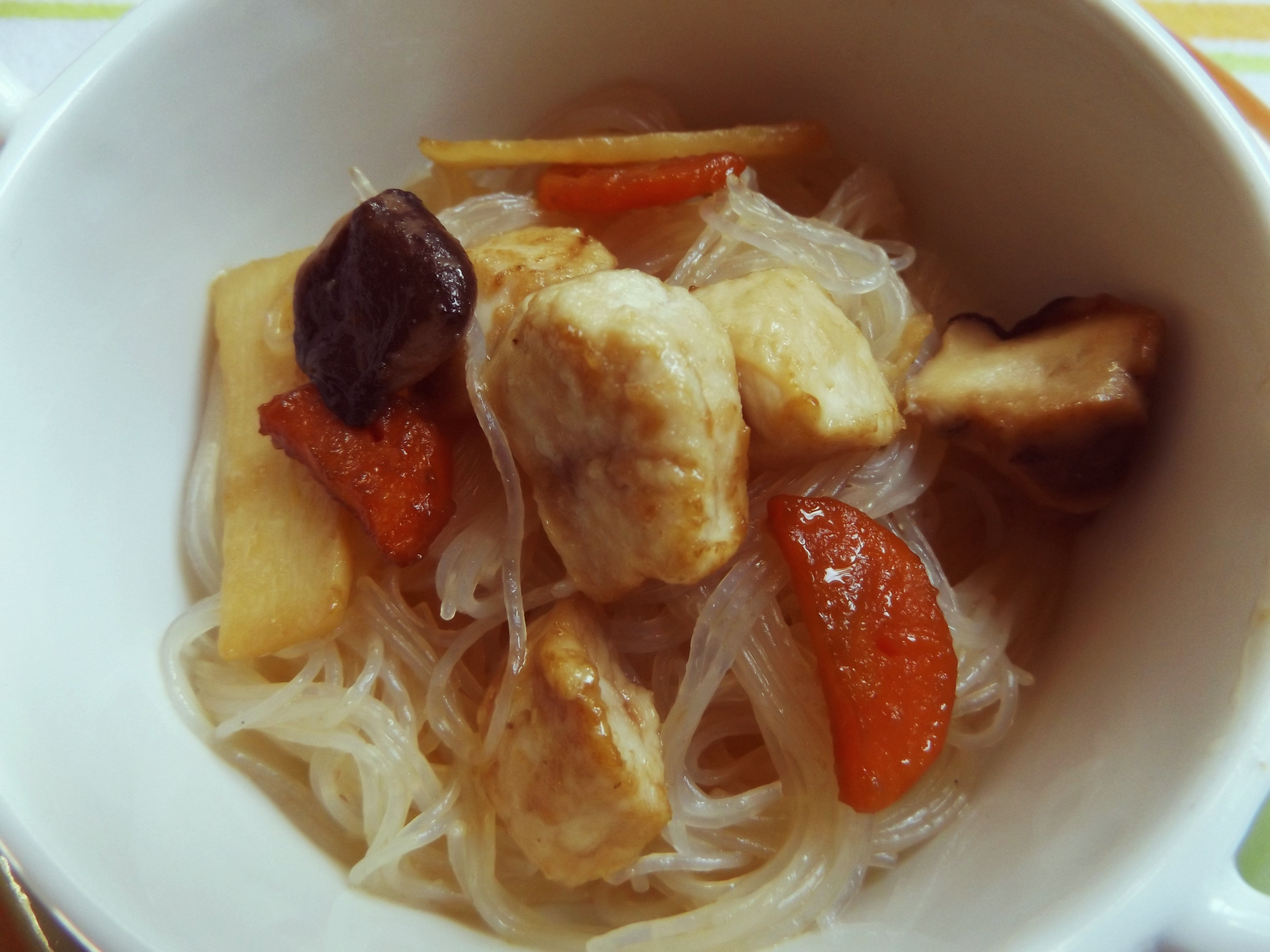 Rice spaghetti with chicken, mushrooms, bamboo and carrots