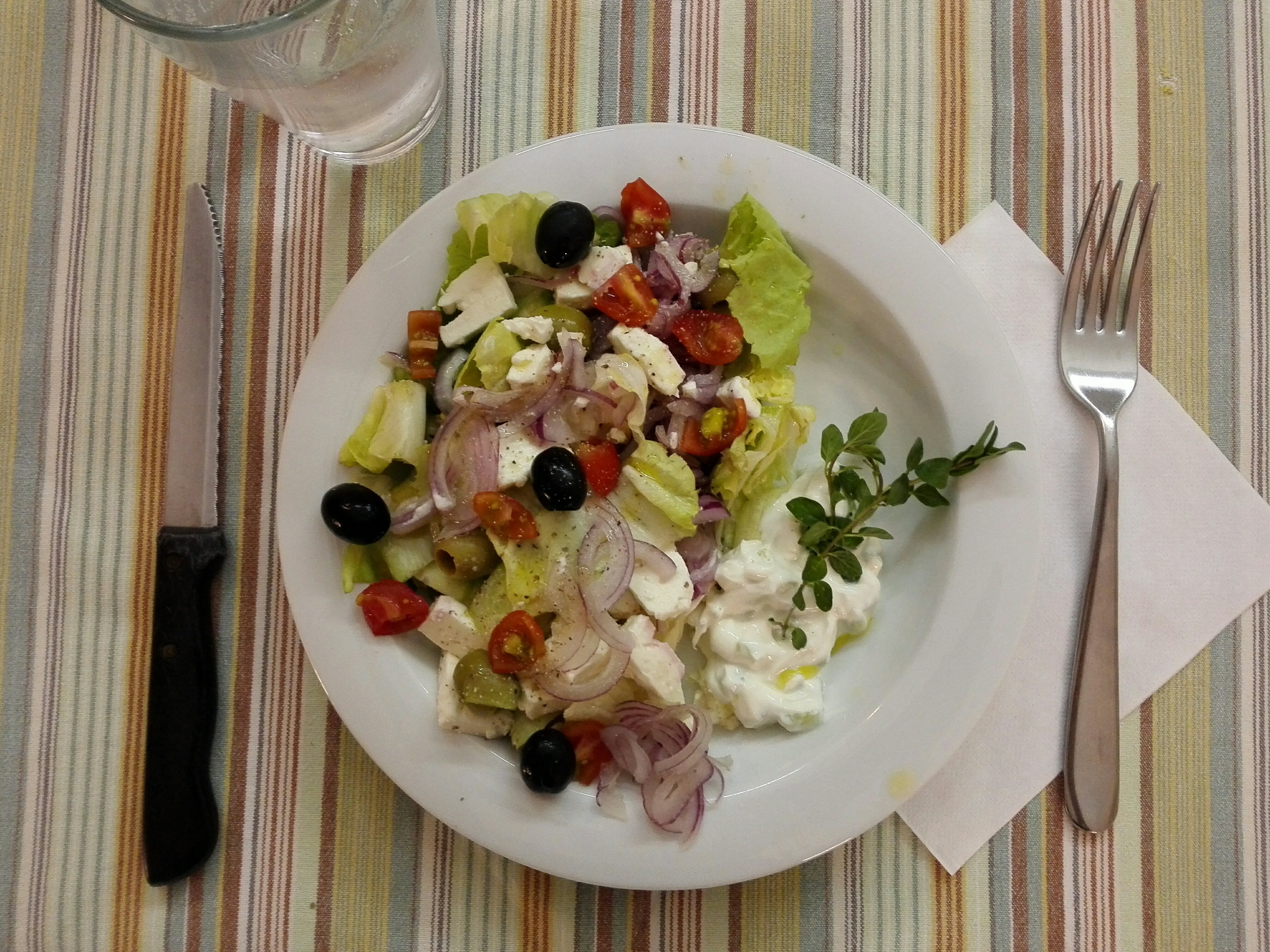 Greek salad with oregano tzatziki