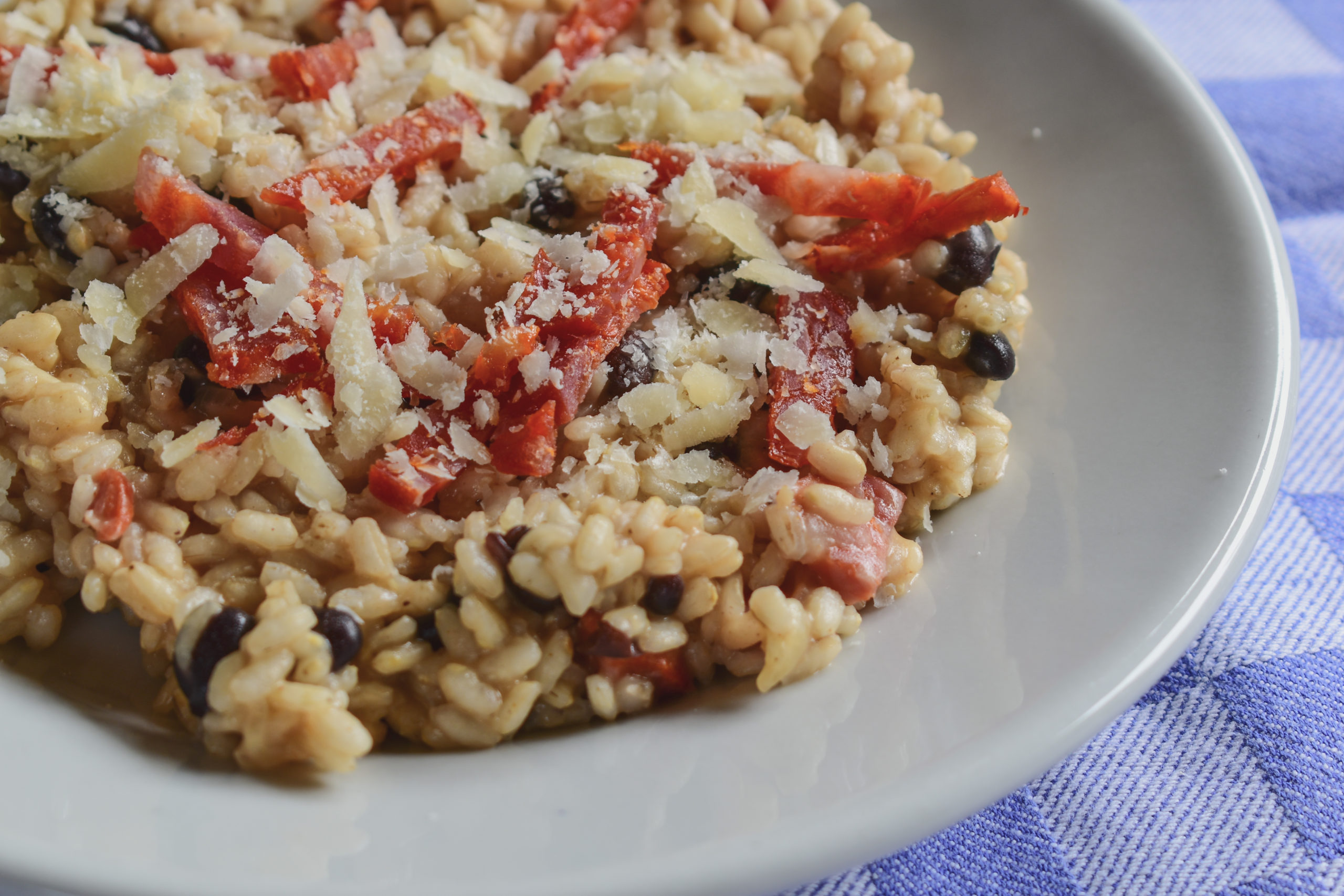 Beer risotto with Napoli sausage and beans
